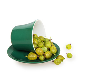 Gooseberries in an inverted green cup on green saucer