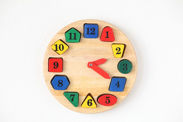 Colorful wooden and any shape clock isolated on a white backgrou