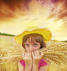 little girl portait in the wheat field