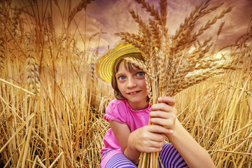 little girl portrait in the wheat field