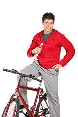 Young man on a bike holding water bottle
