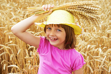 happy little girl and wheat