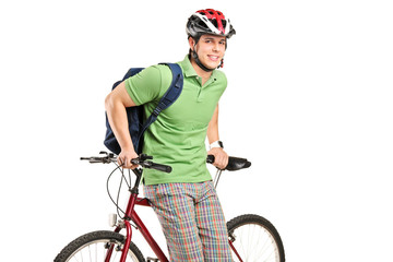 Studio shot of young man with a backpack and bike