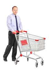 Young man pushing a shopping cart