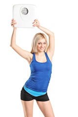Attractive blond woman holding a weight scale