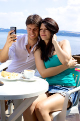 Couple taking pictures of themselves in vacation