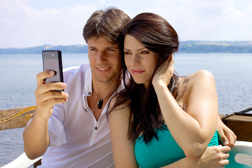 Handsome couple having fun taking selfie in vacation in Italy