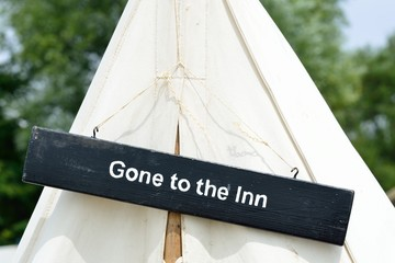 Gone to inn sign