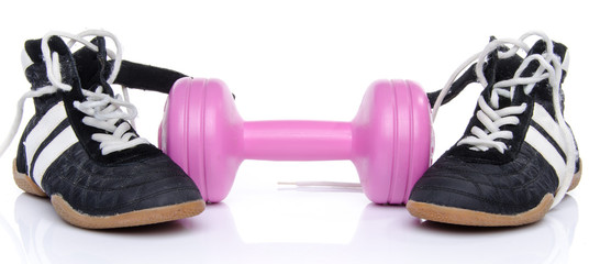 Pink dumbell and fitness shoes