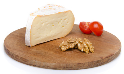 Soft cheese on a wooden board