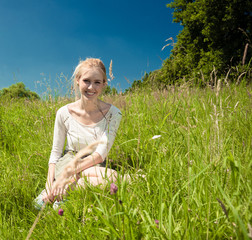young woman in a summer grassland