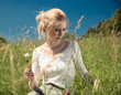 Постер, плакат: young woman in a summer grassland