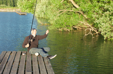 man fishing in a pond