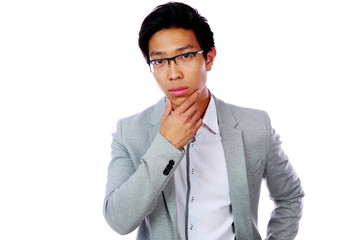 Portrait of a pensive asian man isolated on a white background