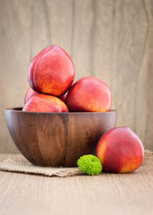 Juicy fresh peaches on  wooden background