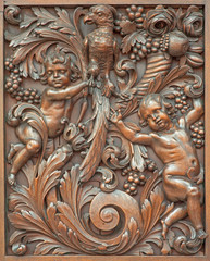 Beruges - carved relief of angels with the bird