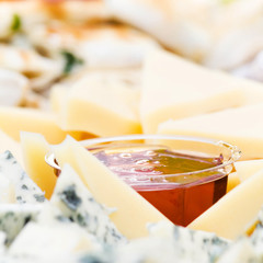 Cheese appetizer with honey macro. Dor Blue Cheese plate with  h