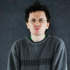 Man in grey sweater.