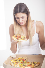 young girl eating pizza