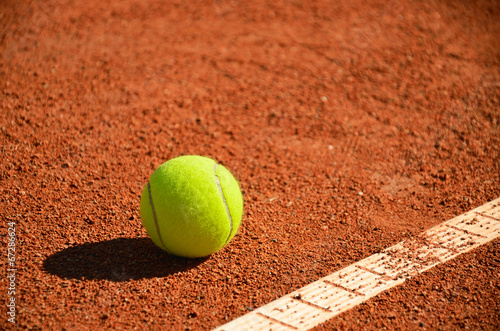 tennis ball near markup diagonal horizontal