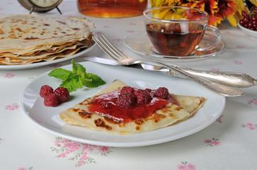 Pancake with raspberry jam