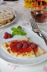Pancake with raspberry jam