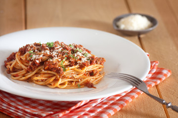 spaghetti bolognese with red napkin