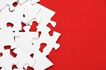 Blank Jigsaw pieces on a bright red background
