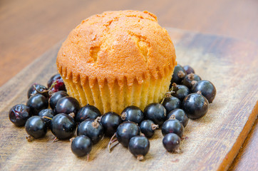 a lemon muffin with blackcurrant