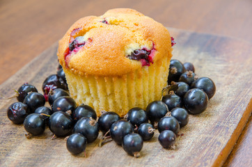 a lemon muffin with cherries and blackcurrant