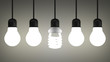 Glowing spiral light bulb hanging among tungsten ones on gray