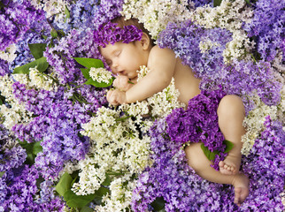 baby in lilac flowers, newborn child greeting card