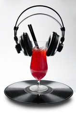 Red Drink vinyl and headphones on isolated background