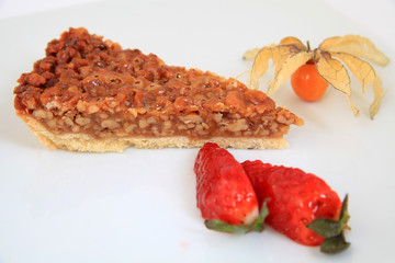 A slice of pecan pie with decoration