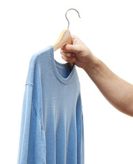 men hand holding hanger with sweater