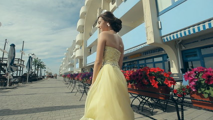Beautiful attractive girl in lemony long rich strapless dress