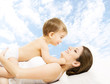 Mother baby happy playing. Child in diaper embracing mama sky