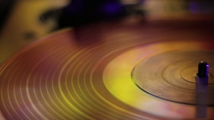 LP rotating disc in yellow and gold tones.