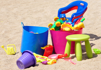 colorful children toys in the sandbox