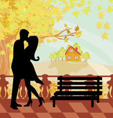 kissing couple in autumn day