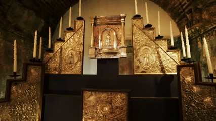 Altar in an ancient church. Candles and golden tones