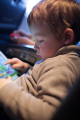 Little boy playing on a tablet computer