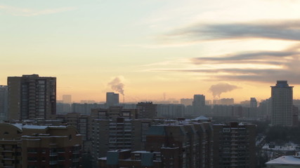 Sunrise over the city. Time lapse.
