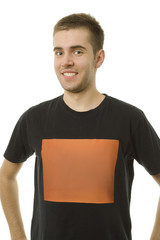 Portrait of a  smiling young man with copy space on T-shirt .