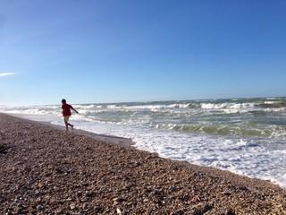 Child runs to the beach