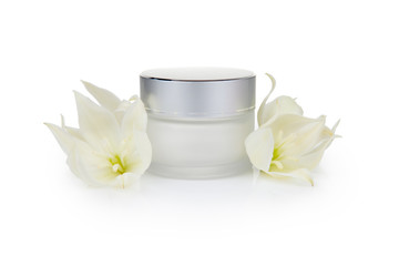 Jar with the cosmetic cream and flowers