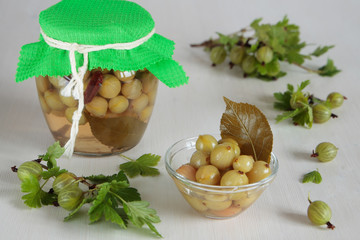 Marinated green gooseberries in bowl