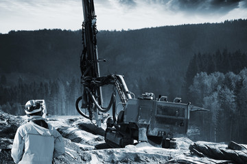 surveying mountain for dynamite blasting, giant drilling