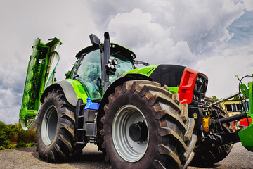 farming tractor and plough, giant tires, latest model