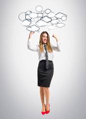 Young businesswoman winning over grey background
